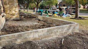 Stone Masons Building a Mortared Stone Garden Wall in Prosper, Texas