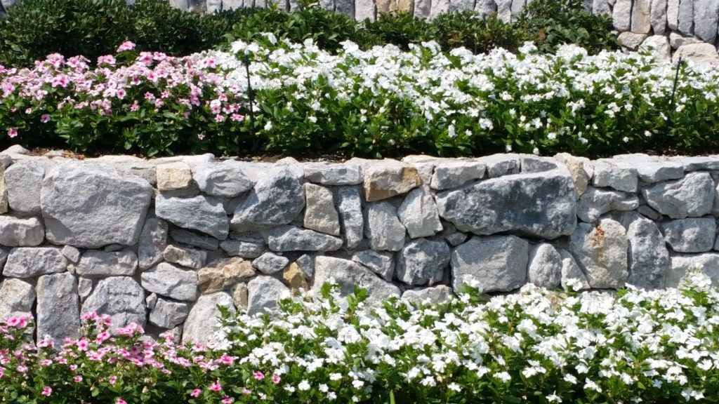 Stone flower bed borders, Prosper TX, mortared stonework, boulder stone retaining walls, outdoor kitchen enclosures, hardscapes
