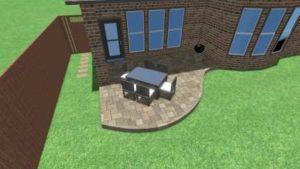 Newly installed backyard paver patio, Zoysia sod and chopped stone edging.